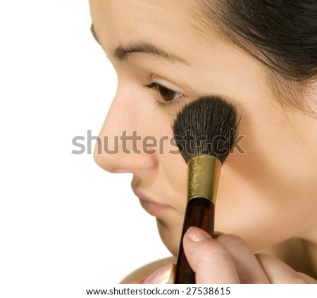 Girl putting make-up isolated
