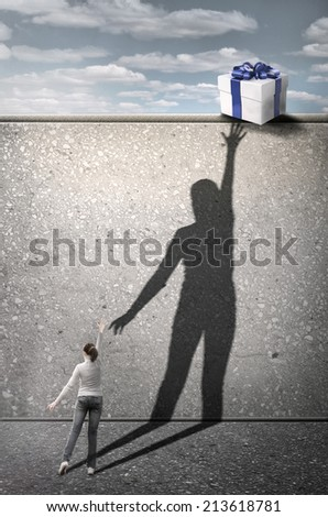 Girl reaches for the gift. Concept graphic - stock photo