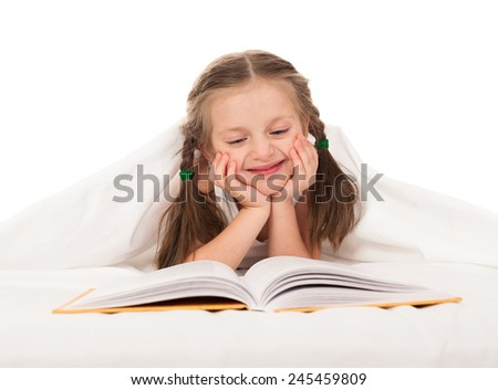 girl read book in white bed - stock photo