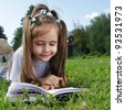 girl read book on grass - stock photo