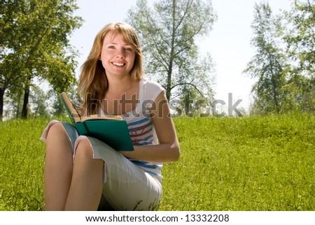 Girl reading a book - stock photo