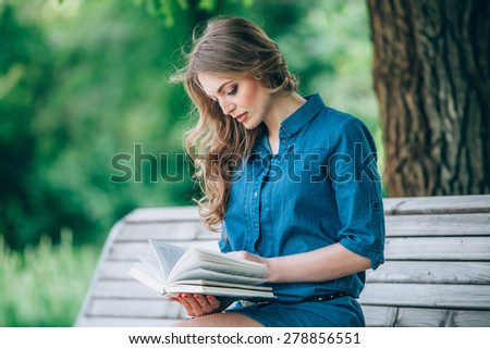 Girl reading a book in park, woman, green - stock photo