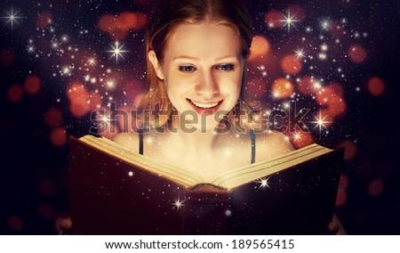 girl reading a magic book - stock photo