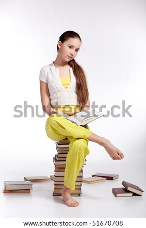 Girl reading book, isolated over white background - stock photo