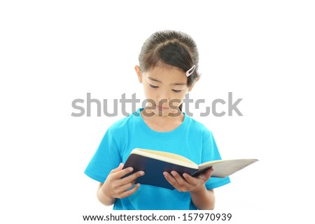 Girl reading her book