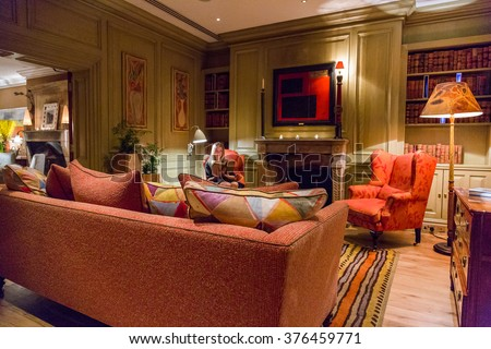 Girl reading in a beautiful gorgeous library room in London - stock photo