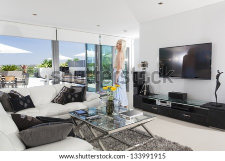Girl reading in luxury living room - stock photo