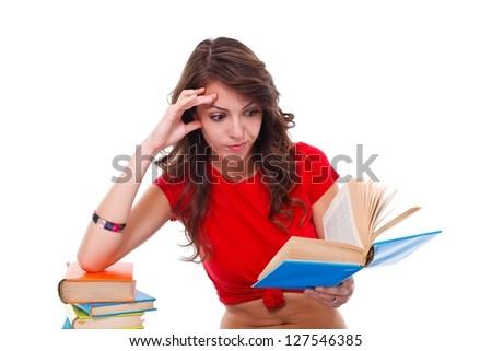 Girl reading interesting book over white background - stock photo