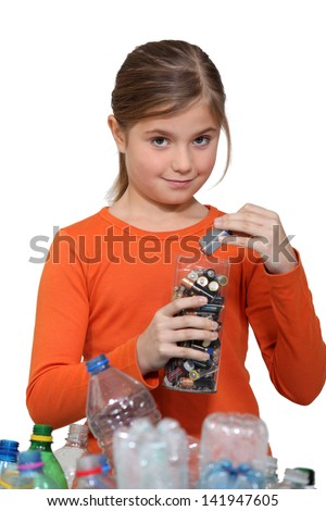 Girl recycling batteries - stock photo