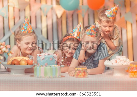 Girl rejoice  in her birthday round about her very emotional friends  - stock photo