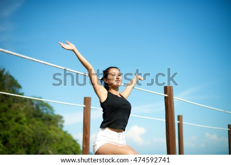 girl relax with arms wide open in the nature