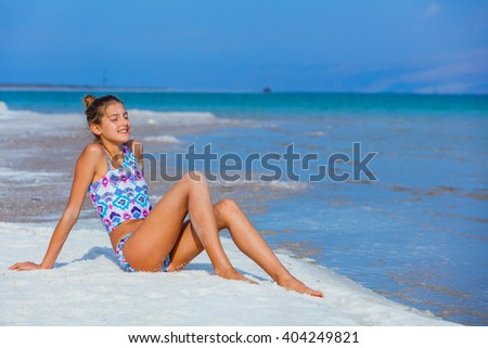 Girl relaxing at the Dead Sea - stock photo
