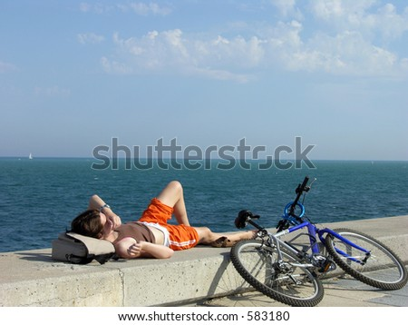 Girl Relaxing At The Ocean