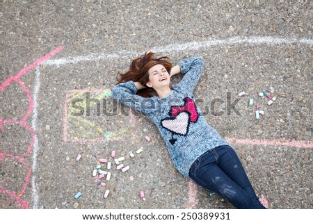 Girl relaxing in drawn house - stock photo
