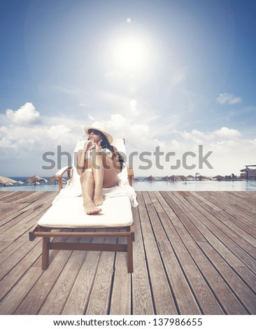 Girl relaxing on a tropical beach resort - stock photo