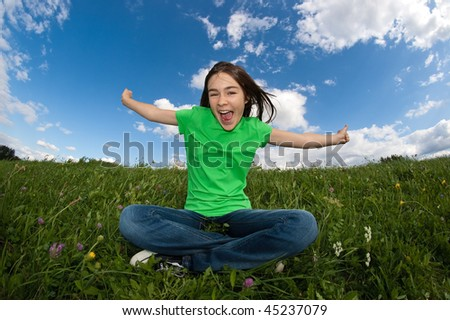 Girl relaxing on green meadow - stock photo