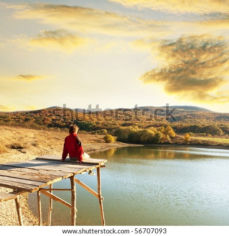 girl relaxing on lake - stock photo
