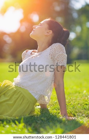 Girl relaxing on meadow - stock photo