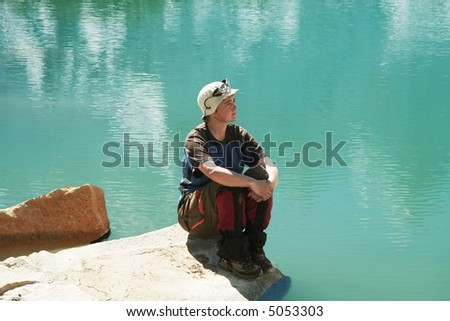 Girl relaxing on mountains lake - stock photo