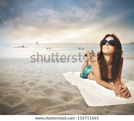 Girl relaxing on the beach - stock photo