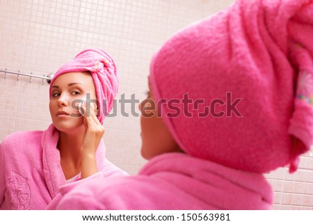 girl removes make-up - stock photo