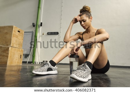 Girl resting after hard workout at the gym - stock photo