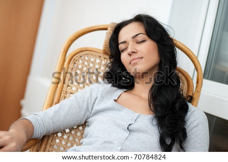 Girl resting in a chair