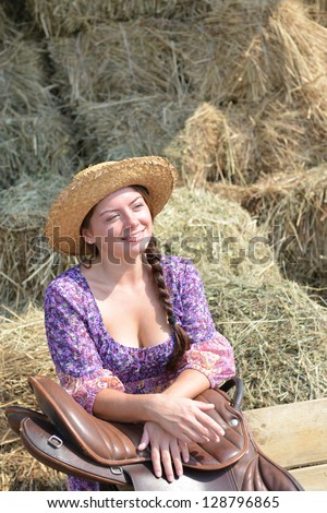Girl resting near a haystack - stock photo