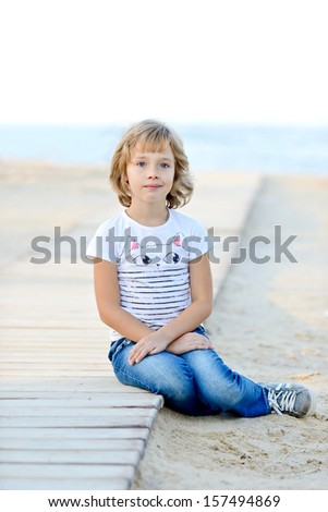 girl resting near the sea - stock photo