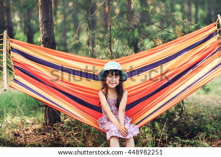 Girl resting on a hammock in forest. - stock photo