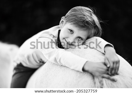 Girl resting on a horse. - stock photo