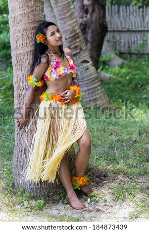 Girl rests on a tree - stock photo