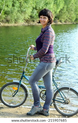 Girl rides a bicycle on the beach