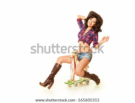 Girl rides toy horse - stock photo
