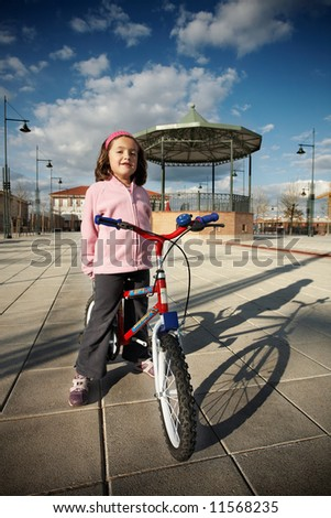 Girl riding a bike - stock photo