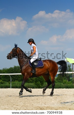 Girl riding a horse - stock photo
