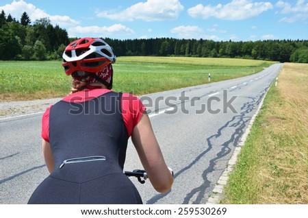 Girl riding a mountain bike - stock photo