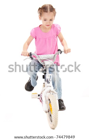 Girl riding bicycle. Isolated on white - stock photo