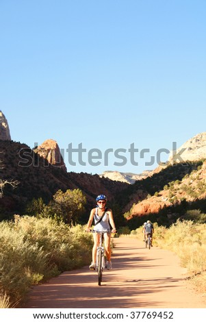 Girl riding bike - stock photo