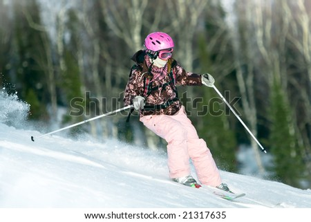 Girl riding fast on skis - stock photo