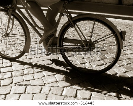 girl riding her old green bicycle, black and white. - stock photo