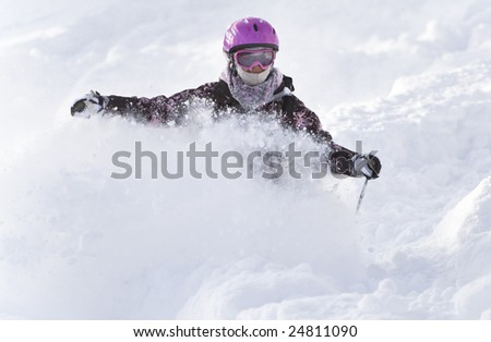 Girl riding on skis in the powder snow - stock photo