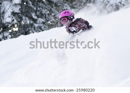 Girl riding on skis in the powder snow