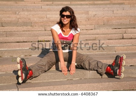 girl-roller sits on the stairs 2 - stock photo