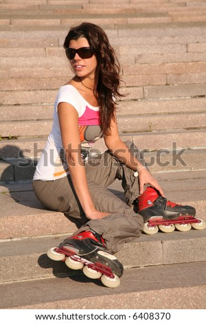 girl-roller sits on the stairs - stock photo