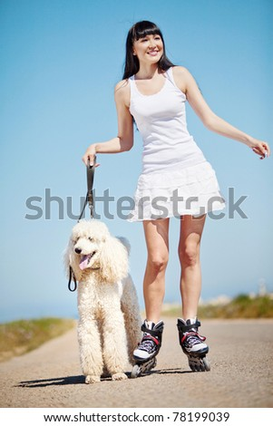 Girl rollerblading, playing sports on the - stock photo