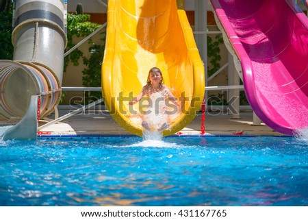 girl rolls down the water slides at the water park