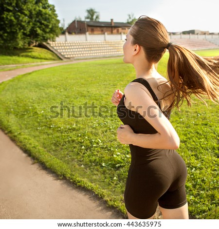 girl runner sprinting outdoors - Sportive people training in a urban area, healthy lifestyle and sport concepts