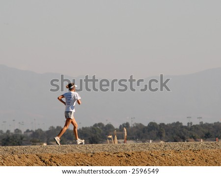 Girl Running Along Dirt Path - stock photo