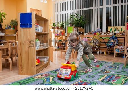 Girl running at kindergarten - stock photo